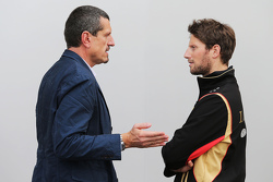(L to R): Guenther Steiner, Haas F1 Team Prinicipal with Romain Grosjean, Lotus F1 Team