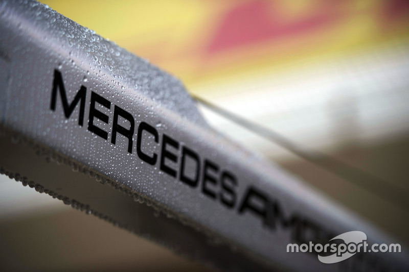 Rain drops on a Mercedes AMG F1 logo