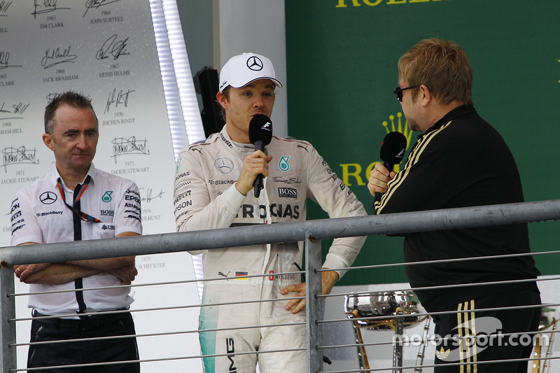 Podium: Paddy Lowe, Mercedes AMG F1 Executive Director, with second place  Nico Rosberg, Mercedes AMG F1 and Sir Elton John
