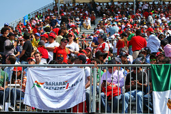 Fans in the grandstand and a Sahara Force India F1 Team flag