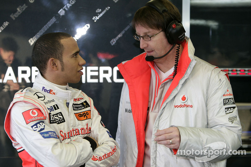 Lewis Hamilton talks with a McLaren engineer