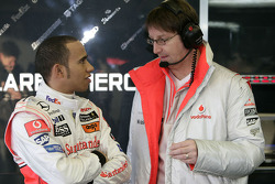 Lewis Hamilton talks with a McLaren engineer