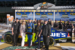 Pole winner Jimmie Johnson celebrates with his team in victory lane