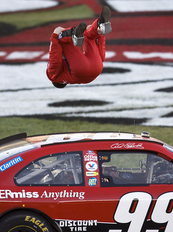 Race winner Carl Edwards celebrates with this traditional backflip