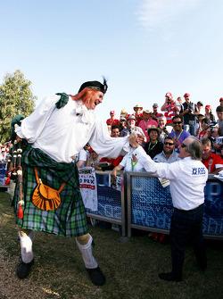 Sir Javkie Stewart and a Scottish fan