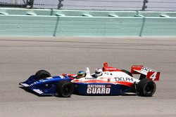 Tennis pro David Nabaldian takes a lap in the IndyCar two-seater driven by Davey Hamilton