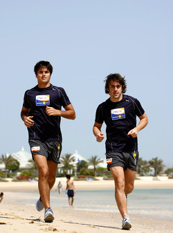 Renault F1 drivers training in Bahrain: Nelson A. Piquet, Renault R28 and Fernando Alonso, Renault R28 run on the beach