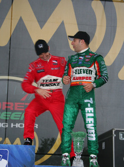 Second place finisher Helio Castroneves jokes with Tony Kanaan