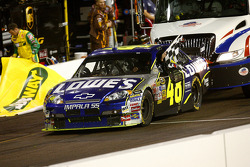 Race winner Jimmie Johson gets a push to victory lane after running out of fuel on the celebration lap
