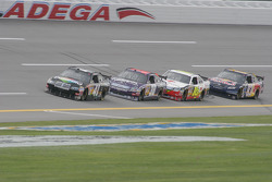 Reed Sorenson leads a group of cars