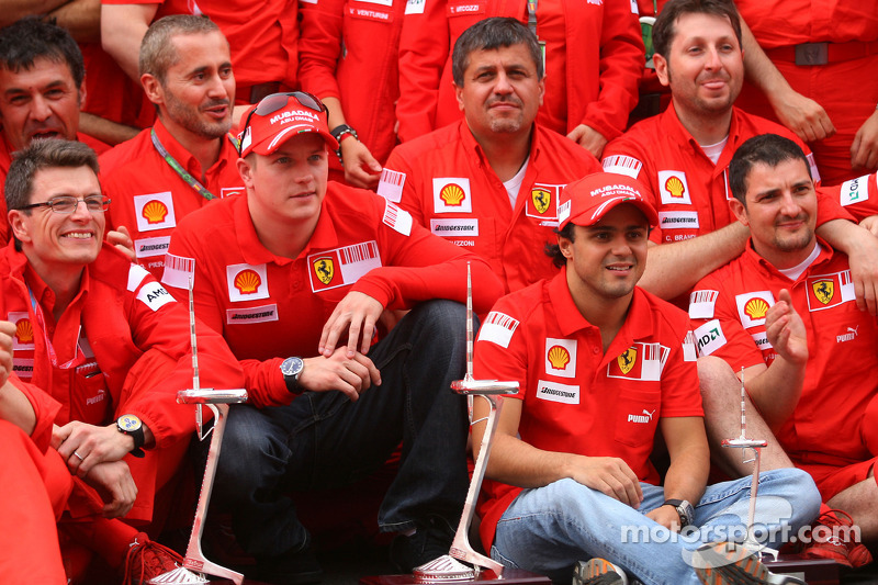 Kimi Raikkonen, Felipe Massa and Scuderia Ferrari team members celebrate win and second place