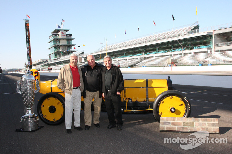 The three four-time Indy 500 winners Rick Mears, A.J. Foyt and Al Unser, pose with the Borg-Warner Trophy and the 1911 Marmon Wasp of 500's first-ever winner, Ray Harroun.