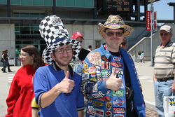 Enthusiastic race fans show the 'thumbs-up'