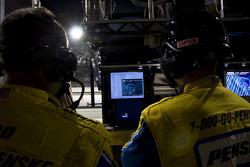 The Penske crew watches Matt Kenseth take the lead
