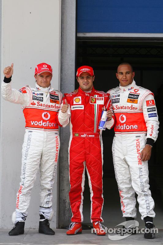 Heikki Kovalainen, McLaren Mercedes with pole winner Felipe Massa, Scuderia Ferrari and Lewis Hamilton, McLaren Mercedes