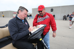 Johnny Rutherford signs an autograph