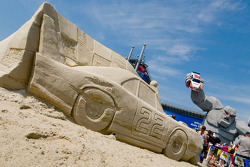 NASCAR fans enjoy the new Dover Sand Scultpture and Dover Monster Monument in Victory Plaza