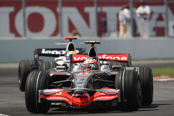 Heikki Kovalainen, McLaren Mercedes, MP4-23 leads Nico Rosberg, WilliamsF1 Team, FW30