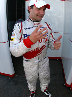 Timo Glock celebrates fourth place finish