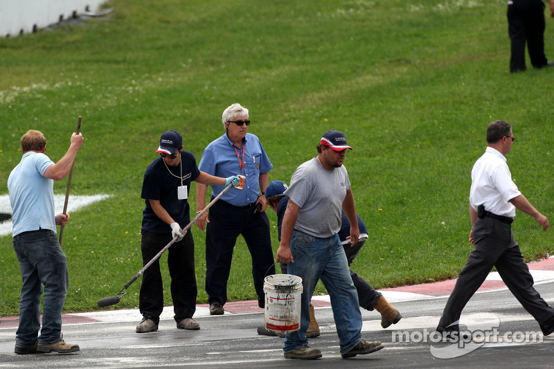 Charlie Whiting, FIA Safty delegate, Race director and offical starter, Herbie Blash, FIA Observer, inspect the circuit condition shortly before the start of the race
