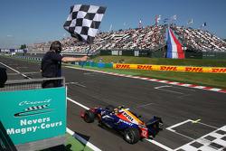 Giorgio Pantano takes the checkered flag