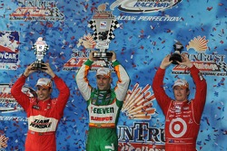 Victory lane: race winner Tony Kanaan, second place Helio Castroneves, third place Scott Dixon