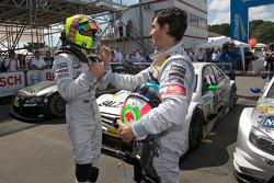 Race winner Jamie Green celebrates with Bruno Spengler