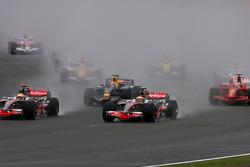 Start: Heikki Kovalainen, McLaren Mercedes, MP4-23 and Lewis Hamilton, McLaren Mercedes, MP4-23, battle for the lead