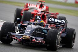 Sébastien Bourdais, Scuderia Toro Rosso leads Kimi Raikkonen, Scuderia Ferrari
