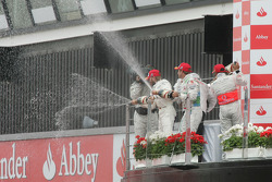 Podium: race winner Lewis Hamilton with second place Nick Heidfeld and third place Rubens Barrichell
