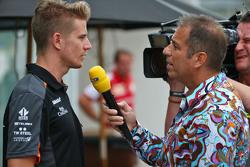 (L to R): Nico Hulkenberg, Sahara Force India F1 with Kai Ebel, RTL TV Presenter