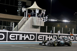 Race winner Nico Rosberg, Mercedes AMG F1 W06 celebrates as he takes the chequered flag at the end o