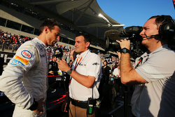 Jenson Button, McLaren with Will Buxton, NBC Sports Network TV Presenter on the grid