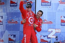 Race winner Scott Dixon celebrates with Helio Castroneves