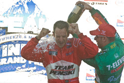 Helio Castroneves and Tony Kanaan celebrate