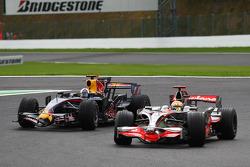 Lewis Hamilton, McLaren Mercedes, MP4-23 passes David Coulthard, Red Bull Racing, RB4