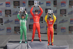 Arie Luyendyk Jr., Ana Beatriz, and Raphael Matos on the podium