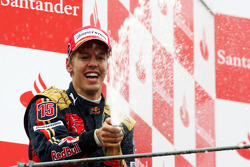 Podium: race winner Sebastian Vettel celebrates with champagne
