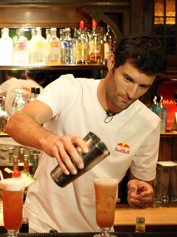 Mark Webber at the Long Bar of the Raffles Hotel mixing the famous Singapore Sling cocktail