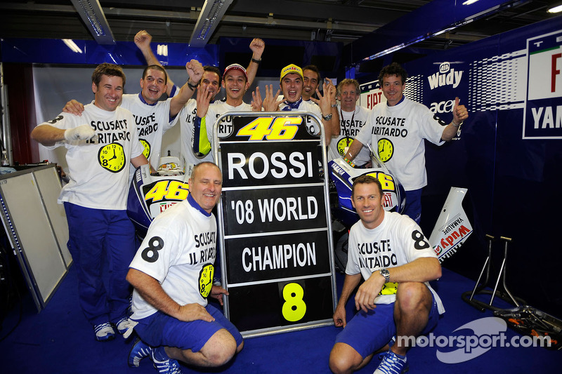 Race winner and 2008 World Champion Valentino Rossi celebrates with Yamaha team members