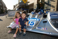 Petit Le Mans preview party at Atlantic Station: young fans pose with the #15 Lowe's Fernandez Racing Acura ARX-01B Acura