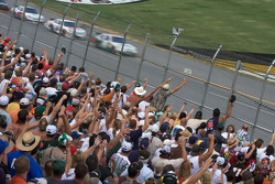 Fans cheer on as Dale Earnhardt Jr. takes the lead