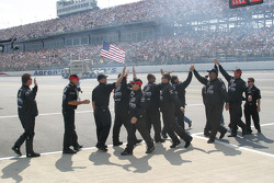 Yates Racing crew members high five after National Anthem
