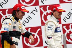 Podium: race winner Fernando Alonso and second place Robert Kubica