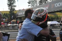 Markus Niemela hugs a crew member