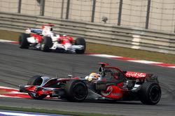 Lewis Hamilton, McLaren Mercedes, MP4-23 leads Jarno Trulli, Toyota Racing, TF108