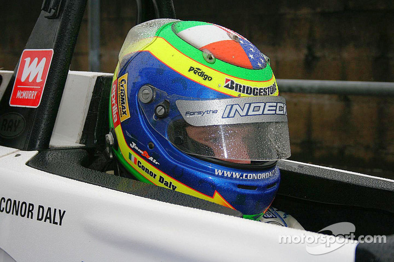 Conor Daly waits in the rain