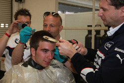Last years winner Philipp Eng on his Formula One drive with the BMW Sauber F1 Team gets a Rookie hair cut from the F1 Team