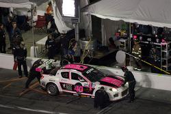 Pit stop for #40 Dempsey Racing Mazda RX-8: Patrick Dempsey, Charles Espenlaub, Joe Foster