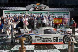 DP victory lane: class and overall winners David Donohue, Antonio Garcia, Darren Law and Buddy Rice celebrate with JC France and Brumos Racing team members